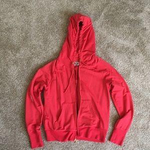Juicy Couture red sweatshirt.
